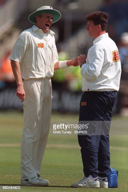 England's Dominic Cork gets some treatment on his injured finger from physiotherapist Dave Roberts