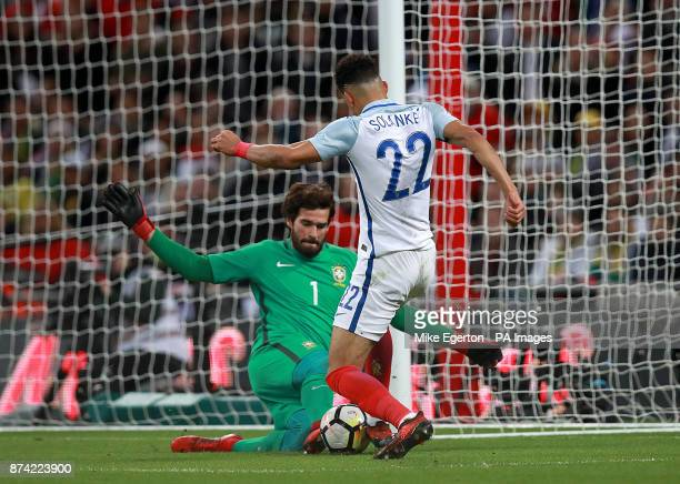 England's Dominic Solanke has a shot blocked by Brazil goalkeeper Alisson Becker during the Bobby Moore Fund International match at Wembley Stadium...