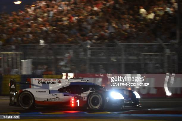 England's driver Nick Tandy competes on his Porsche 919 Hybrid N°1 during the fourth the qualifying practice session of the Le Mans 24 hours...