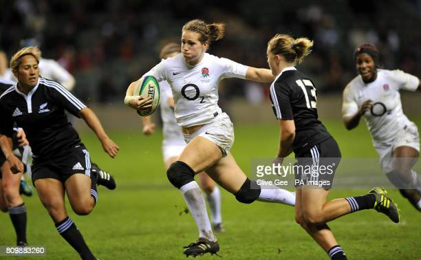 England's Emily Scarratt runs past New Zealand's Kelly Brazier during the Autumn International match at Twickenham Stadium London
