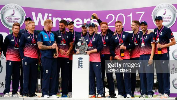 England's Eoin Morgan poses with the trophy after England won their OneDay International series at the end of the third OneDay International cricket...