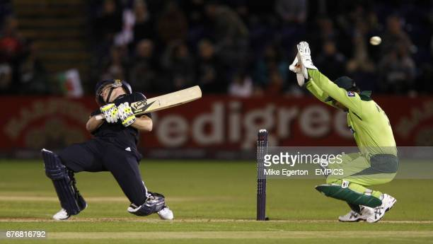 England's Eoin Morgan takes evasive action to avoid be hit by a bouncer from Pakistan's Shahid Afridi