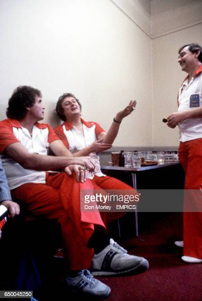 England's Eric Bristow explains to teammates Bobby George and Alan Glazier about the elbow injury he sustained playing darts