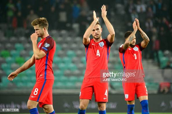 England's Eric Dier Jordan Henderson and Kyle Walker react after the World Cup qualifying football match between Slovenia and England at Stozice...