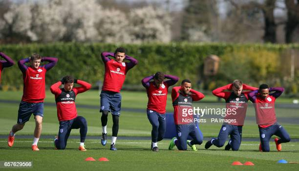 England's Eric Dier Ross Barkley Dele Alli Alex OxladeChamberlain Ryan Bertand Luke Shaw and Nathaniel Clyne during the training session at Enfield...