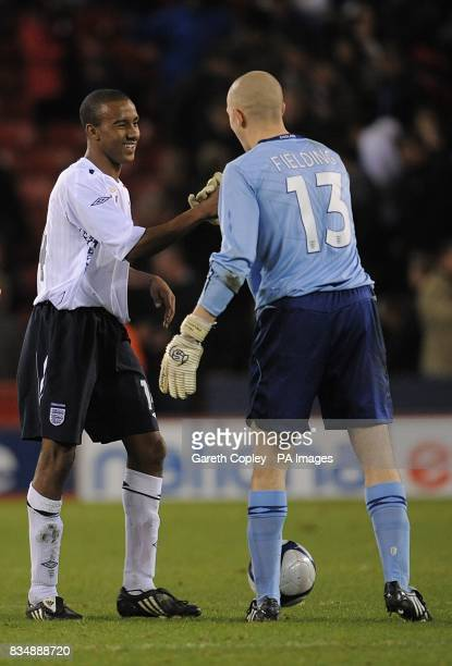 England's Fabian Delph shakes hands with England goalkeeper Frank Fielding after the final whistle