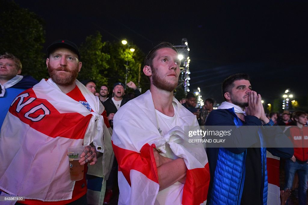 England's fans watch the football match between Iceland and England at the Champ-de-Mars fan zone in Paris on June, 27, 2016. / AFP / BERTRAND