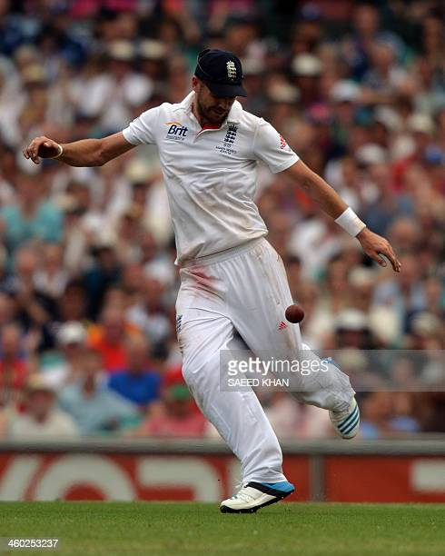 England's fielder James Anderson celebrates the after catching Australia's batsman Ryan Harris on the first day of the fifth Ashes cricket Test at...