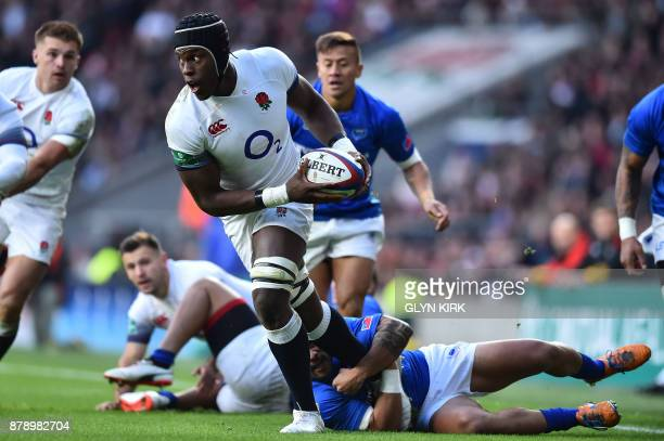 England's flanker Maro Itoje is tackled during the autumn international rugby union test match between England and Samoa at Twickenham stadium in...