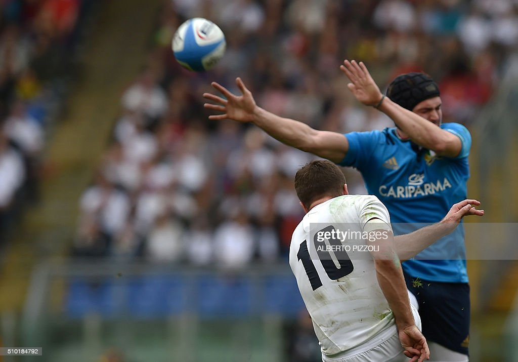 England's fly half George Ford kicks (L) the ball during the Six Nations international rugby union match between Italy and England on February 14, 2016 at Olympic stadium in Rome. / AFP / ALBERTO PIZZOLI
