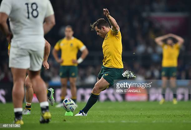England's fly half Owen Farrell kicks a penalty awarded after England received a yellow card during a Pool A match of the 2015 Rugby World Cup...