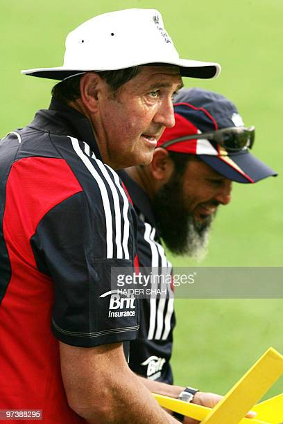 England's former cricket player Graham Gooch chats with Pakistan's former spinner and England's bowling coach Mushtaq Ahmed during the second...