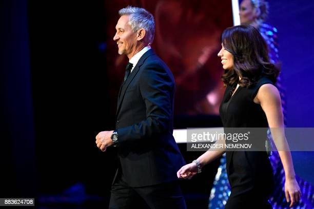 England's former forward and draw conductor Gary Lineker and Russian sports journalist and draw conductor Maria Komandnaya arrive on stage during the...