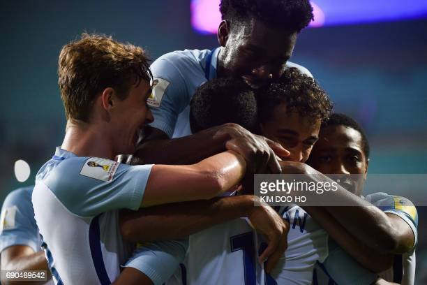 England's forward Ademola Lookman is congratulated by teammates after scoring during their U20 World Cup round of 16 football match between England...