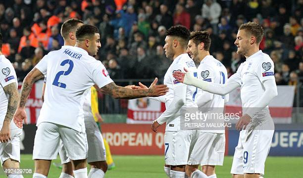 England's forward Alex OxladeChamberlain celebrates with teammates scoring during the Euro 2016 Group E qualifying football match between Lithuania...