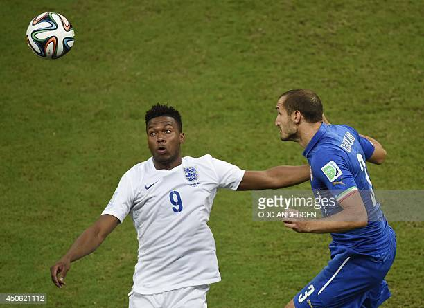 England's forward Daniel Sturridge and Italy's defender Giorgio Chiellini vie for the ball during a Group D football match between England and Italy...