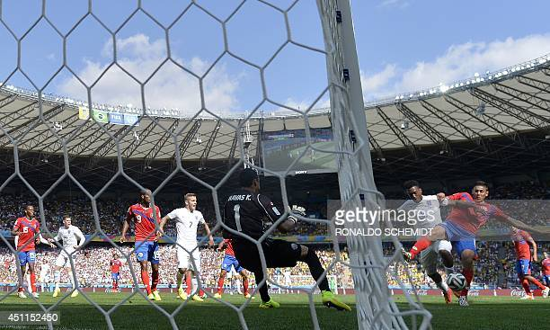 England's forward Daniel Sturridge challenges Costa Rica's goal during a Group D match between Costa Rica and England at the Mineirao Stadium in Belo...