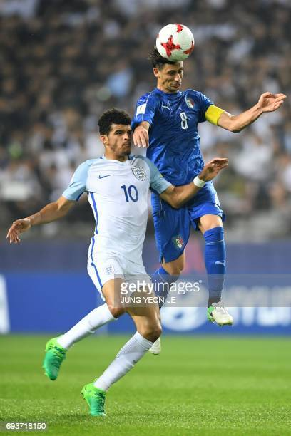 England's forward Dominic Solanke and Italy's midfielder Rolando Mandragora compete for the ball during the U20 World Cup semifinal football match...