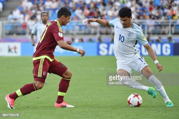 England's forward Dominic Solanke and Venezuela's defender Ronald Hernandez compete for the ball during the U20 World Cup final football match...