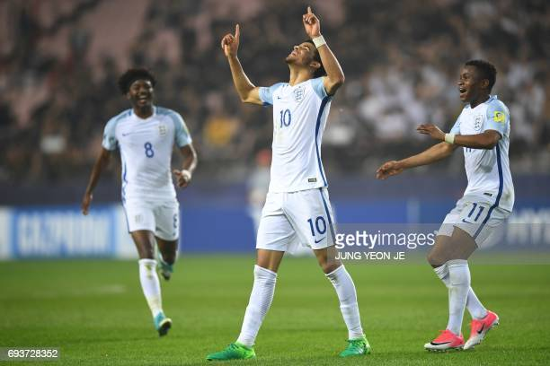 England's forward Dominic Solanke celebrates his goal during the U20 World Cup semifinal football match between England and Italy in Jeonju on June 8...