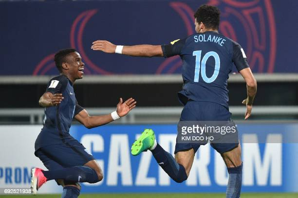 England's forward Dominic Solanke celebrates his goal with forward Ademola Lookman during the U20 World Cup quarterfinal football match between...