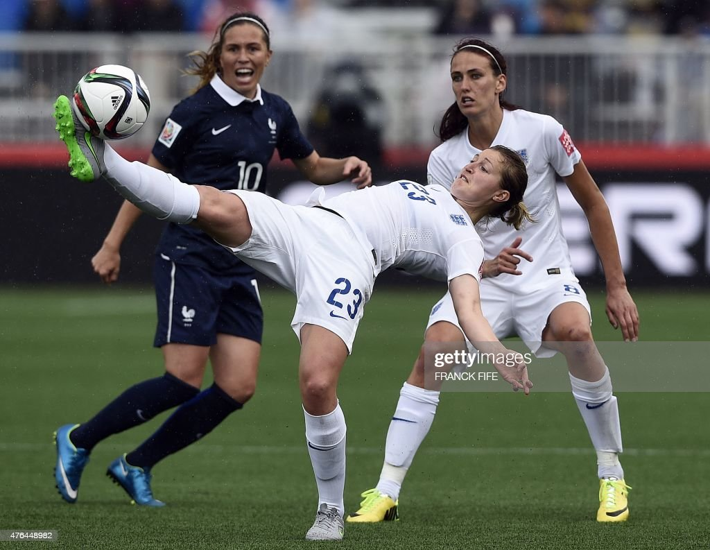 England's forward Ellen White (C) kicks the ball in front France's midfielder Camille Abily (C) during a Group F match at the 2015 FIFA Women's World Cup between France and England at Moncton Stadium in Moncton, New Brunswick on June 9, 2015.