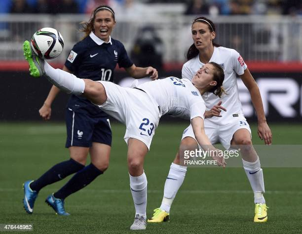 England's forward Ellen White kicks the ball in front France's midfielder Camille Abily during a Group F match at the 2015 FIFA Women's World Cup...