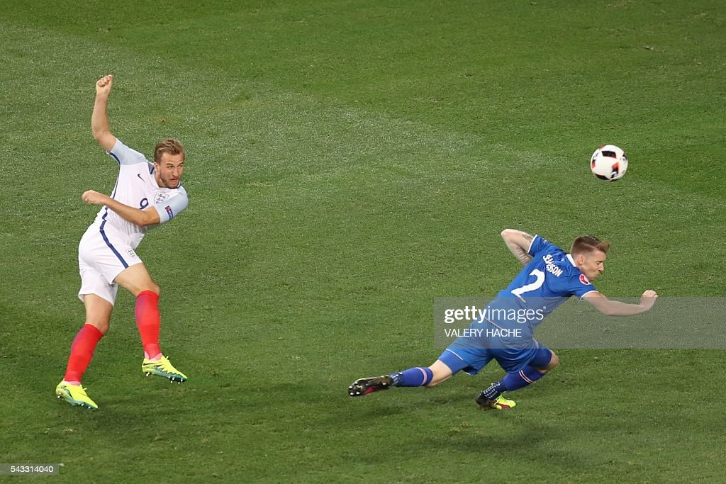 England's forward Harry Kane (L) and Iceland's defender Birkir Saevarsson vie for the ball during the Euro 2016 round of 16 football match between England and Iceland at the Allianz Riviera stadium in Nice on June 27, 2016. / AFP / Valery HACHE