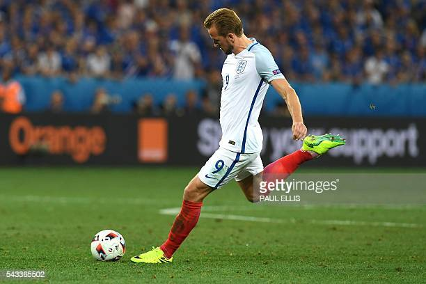 England's forward Harry Kane shoots the ball during Euro 2016 round of 16 football match between England and Iceland at the Allianz Riviera stadium...
