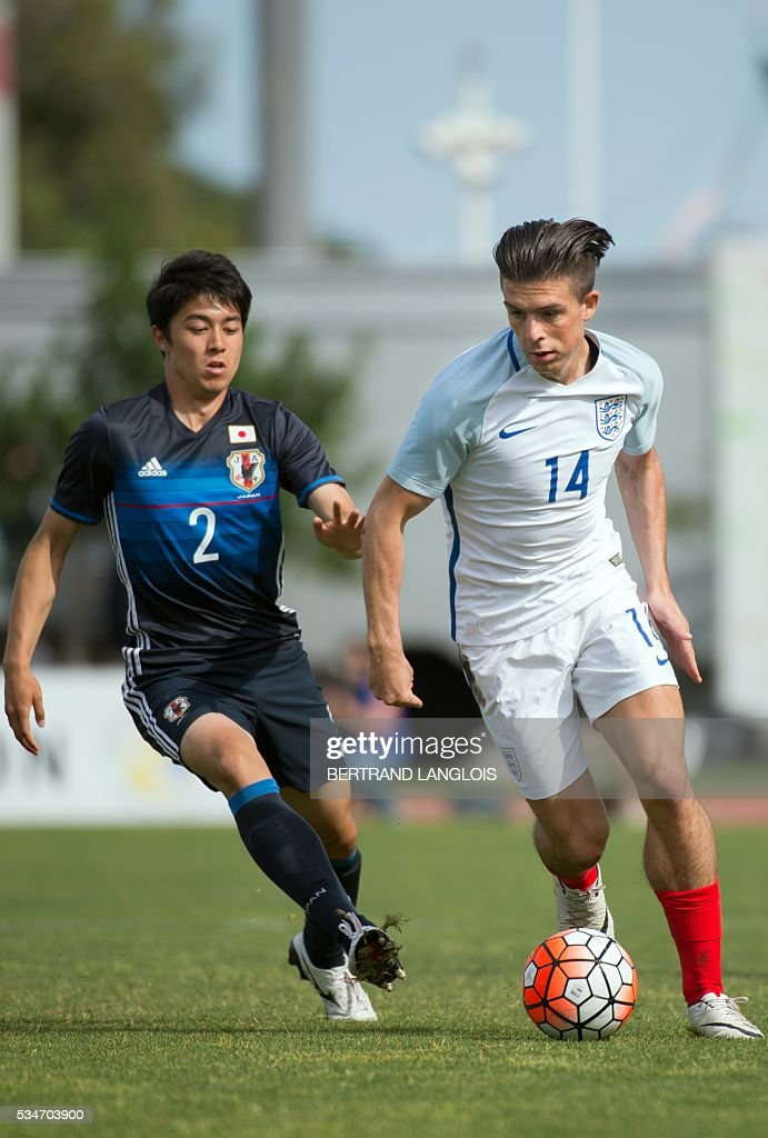 England's forward Jack Grealish (R) vies with Japan's defender Sai Van Vermeskerken during the 'Festival International Espoirs' Under 21 football match at the Leo-Lagrange stadium in Toulon, southern France, on May 27, 2016. LANGLOIS