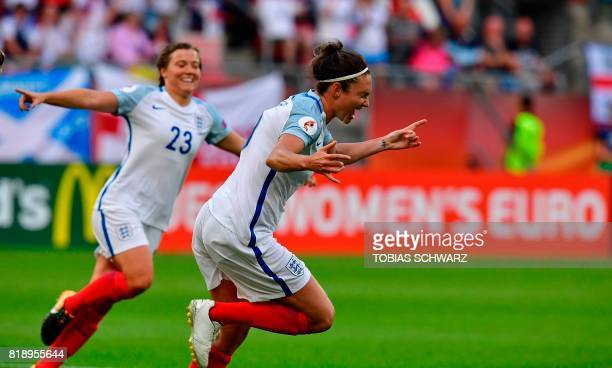 England's forward Jodie Taylor celebrates with Francesca Kirby after scoring during the UEFA Women's Euro 2017 football tournament match between...