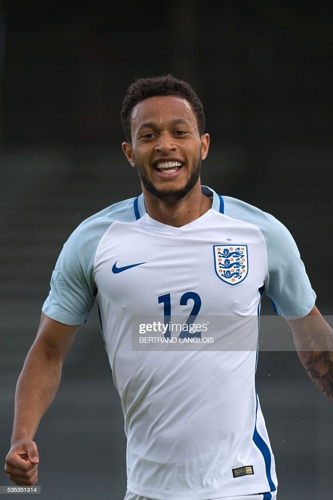 England's forward Lewis Baker celebrates after scoring during the Festival International Espoirs Under 21 football match final France vs England at the Parc des Sports stadium in Avignon, southern France, on May 29, 2016. / AFP / BERTRAND
