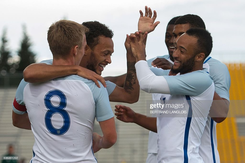 England's forward Lewis Baker celebrates with teammates after scoring during the Festival International Espoirs Under 21 football match final France vs England at the Parc des Sports stadium in Avignon, southern France, on May 29, 2016. / AFP / BERTRAND