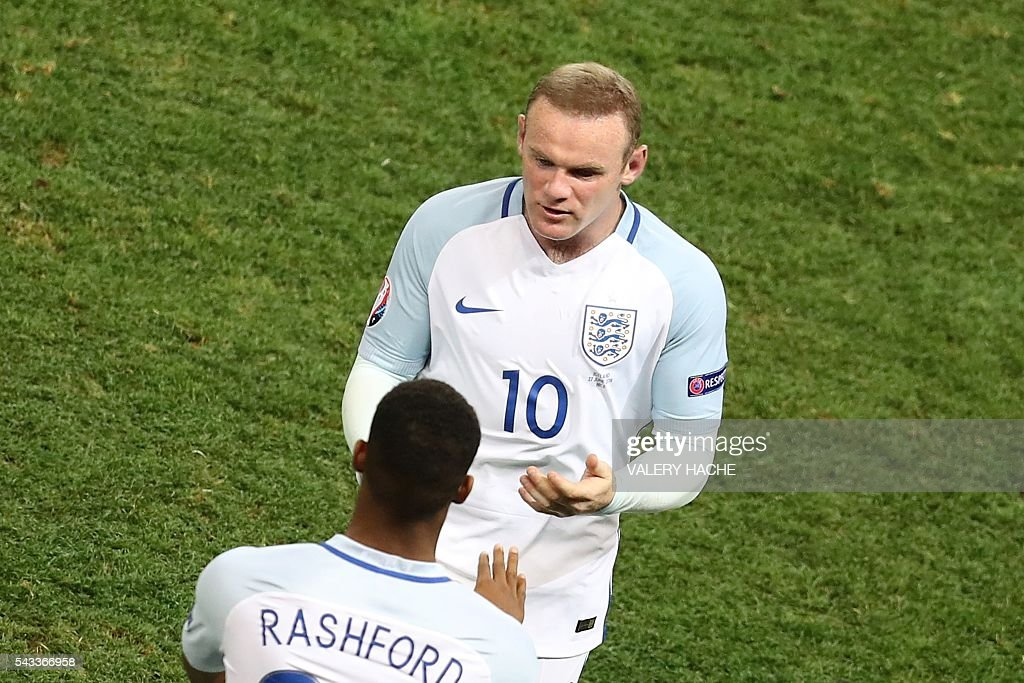 England's forward Marcus Rashford enters the pitch for England's forward Wayne Rooney during the Euro 2016 round of 16 football match between England and Iceland at the Allianz Riviera stadium in Nice on June 27, 2016. / AFP / Valery HACHE