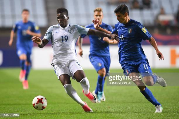 England's forward Sheyi Ojo and Italy's midfielder Matteo Pessina compete for the ball during the U20 World Cup semifinal football match between...
