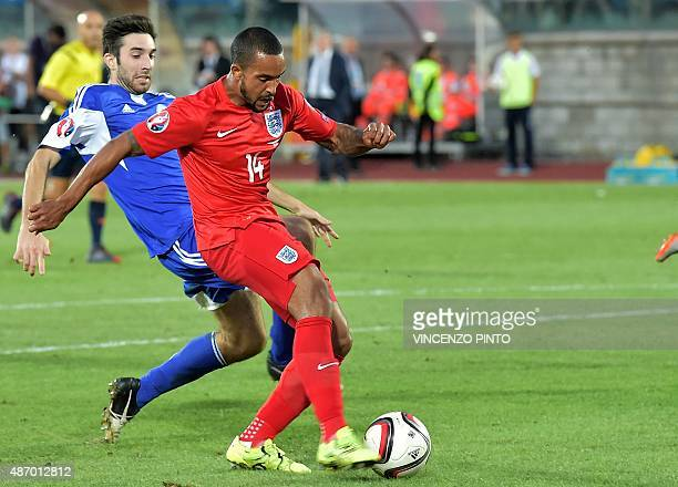 England's forward Theo Walcott scores during the EURO 2016 qualifying football match San Marino vs England at the San Marino stadium in Serravalle on...