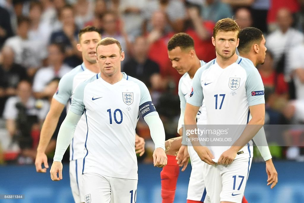 England's forward Wayne Rooney and England's midfielder Eric Dier look on during the Euro 2016 round of 16 football match between England and Iceland at the Allianz Riviera stadium in Nice on June 27, 2016. / AFP / BERTRAND