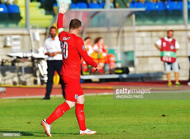 England's forward Wayne Rooney celebrates after scores against San Marino during the EURO 2016 qualifying football match San Marino vs England at the...