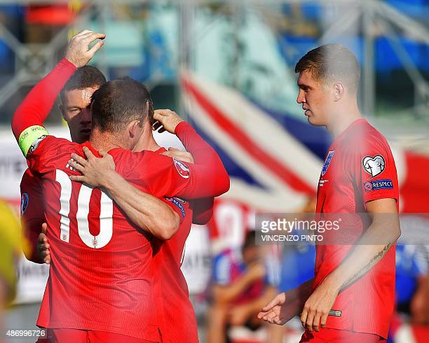 England's forward Wayne Rooney celebrates after scoring against San Marino during the EURO 2016 qualifying football match San Marino vs England at...