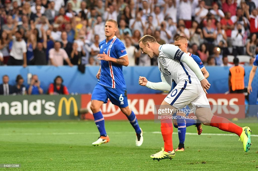 England's forward Wayne Rooney celebrates scoring the opening goal during the Euro 2016 round of 16 football match between England and Iceland at the Allianz Riviera stadium in Nice on June 27, 2016. / AFP / BERTRAND