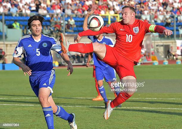 England's forward Wayne Rooney controls the ball over San Marino's defender Davide Simoncini during the EURO 2016 qualifying football match San...