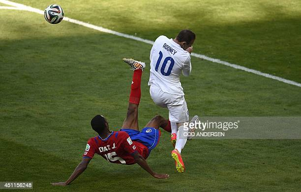 England's forward Wayne Rooney reacts after a challenge from Costa Rica's defender Junior Diaz during the Group D football match between Costa Rica...