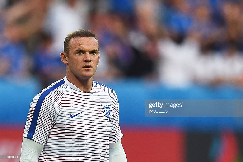 England's forward Wayne Rooney warms up prior to the Euro 2016 round of 16 football match between England and Iceland at the Allianz Riviera stadium in Nice on June 27, 2016. / AFP / PAUL
