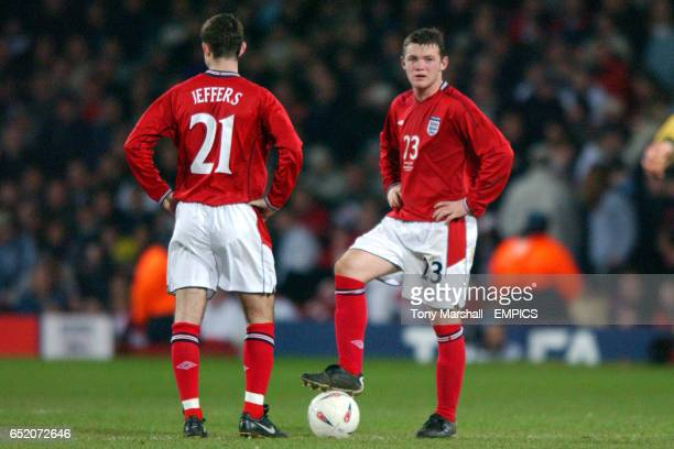 England's Francis Jeffers and debutant Wayne Rooney stand dejected as they prepare to kick off after conceding a third goal against Australia