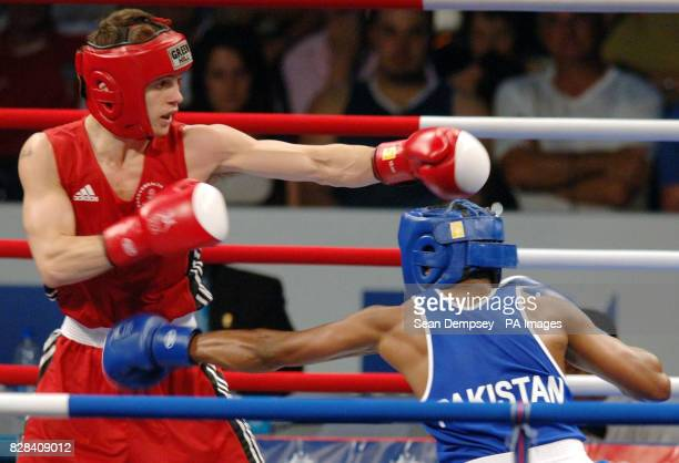 England's Francis Smith in action against Pakistan's Lassi Mehrullah during the Featherweight 57 kg final at the Melbourne Exhibition Centre during...