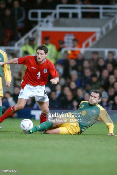 England's Frank Lampard and Australia's Mark Viduka battle for the ball