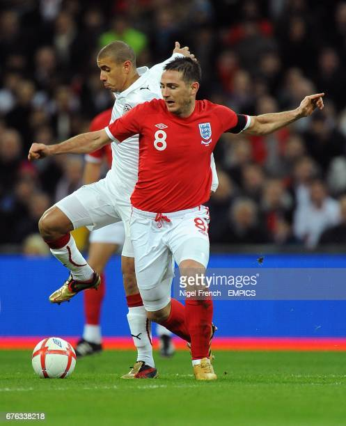 England'S Frank Lampard and Egypt's Mohamed Zidan battle for the ball