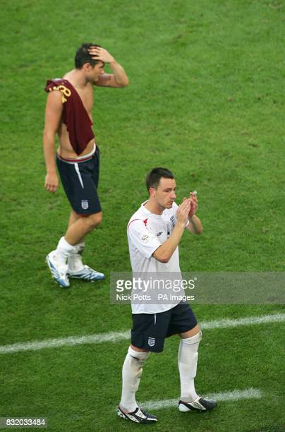 England's Frank Lampard and John Terry leave the pitch at the end of the match