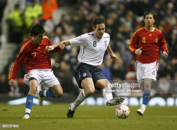 England's Frank Lampard and Spain's David Villa battle for the ball as Garcia Sergio Ramos looks on