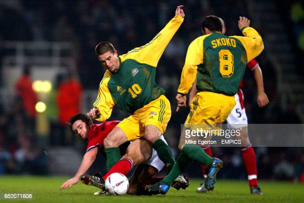 England's Frank Lampard battles for the ball with Australia's Harry Kewell and Josip Skoko